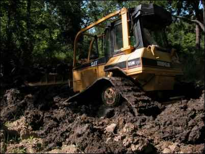 bulldozer in mud